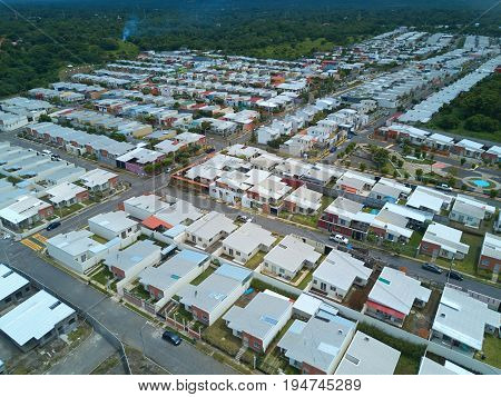 Many houses in residential area above view. City development drone view