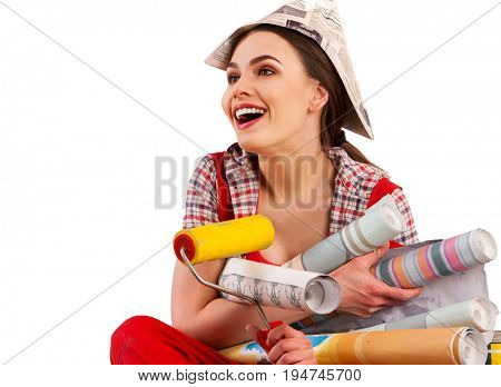 Repair home woman holding paint roller for wallpaper. Girl in newspaper cap renovation apartment on isolated. Girl is happy to choose right materials number one.