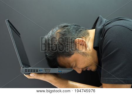 Asian Man Hold Computer Notebook In Stress Gesture
