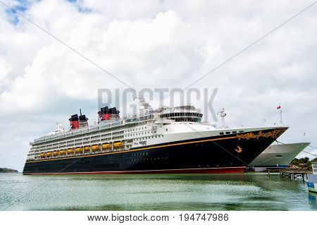 Large Luxury Cruise Ship Disney Wonder On Sea Water And Cloudy Sky Background Docked At Port Of Nass