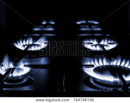 Household gas oven stove with the gas flame on fire
