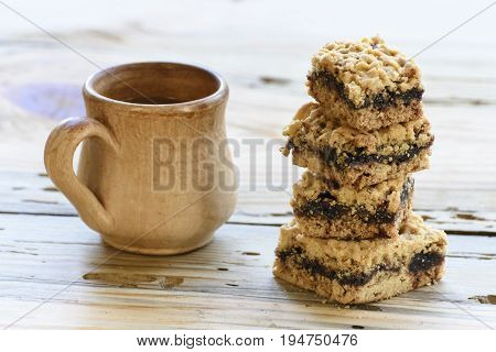 Homemade cookies and cup of coffe on wooden table.