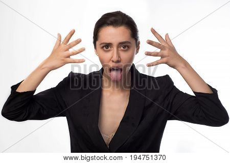 Dissatisfied Businesswoman Showing Tongue At The Camera