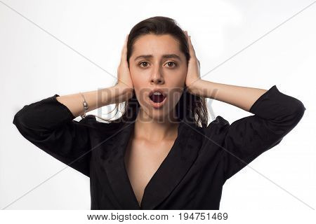 Young Businesswoman Covering Her Ears And Shouting Over White Background