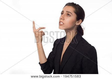 young woman thinking against concrete white wall