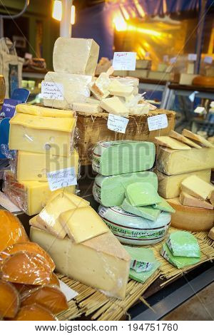 MUNICH GERMANY - MAY 9 2017 : Different kinds of cheese displayed at the outdoor food market near Marienplatz in Munich Germany.