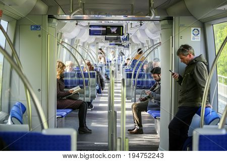 MUNCHEN GERMANY - MAY 9 2017 : People in train on the subway system in Munich Germany. About 350 million passengers ride the U-Bahn every year.