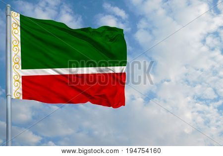 National flag of Chechen Republic on a flagpole in front of blue sky.
