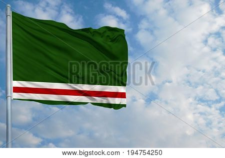National flag of Chechen Republic of Ichkeria on a flagpole in front of blue sky.