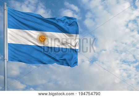 National flag of Argentina on a flagpole in front of blue sky.
