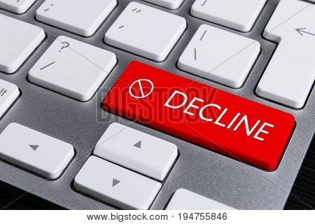 Close up view of a Computer notebook keyboard with one red button with word DECLINE technology background empty space for text