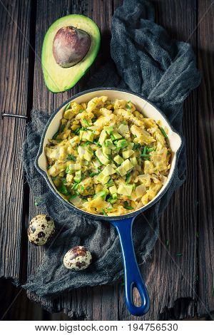 Closeup Of Healthy Scrambled Eggs With Avocado For Breakfast