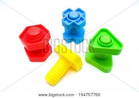 Children's Colorful Toys Bolts And Nut, Isolated On A White Background