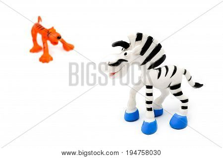Children's Plastic Toy Zebra And Tiger, Isolated On A White Background