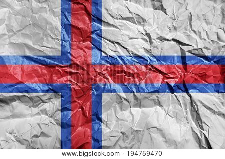 Faroe Islands flag painted on crumpled paper background
