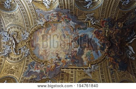 ROME ITALY - MAY 27 2017: Baroque paintings on the ceiling of the Church of the Gesù Triumph of the Name of Jesus by Giovanni Battista Gaulli