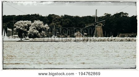 Old Fashioned Black And White Photo Of Joppe Lake With Windmill In Summertime. Warmond. Zuid-holland