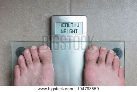 Man's Feet On Weight Scale - Healthy Weight