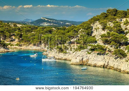 Amazing Calanque De Port Pin bay with sailing boats and luxury yachts Calanques National Park near Cassis fishing village Provence South France Europe
