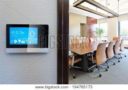 smart screen on wall in modern meeting room