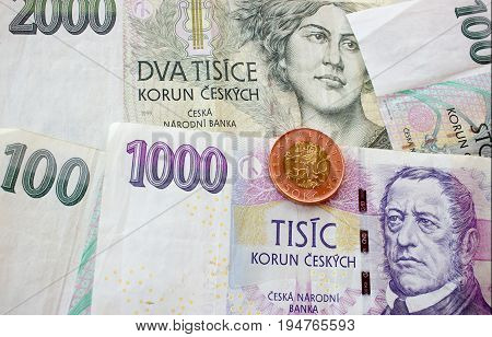Czech coin on the various Czech banknotes money like background.
