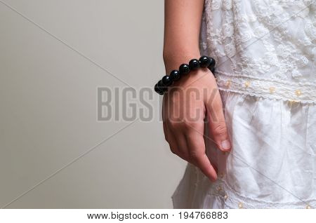 Black beads bracelet on girl hand. Can be used as fashion accessories also as praying beads for counting prayers or practicing mindfulness meditation. Some believe black stone has protection power.