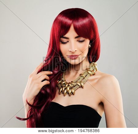 Glamorous Redhead Model Woman with Red Curly Hair. Beautiful Girl Pretty Female Face