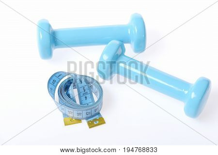 Pair Of Dumbbells And Rolled Blue Measuring Tape