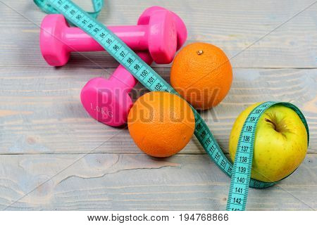 Gym And Health Concept, Dumbbells Weight With Measuring Tape ,fruit