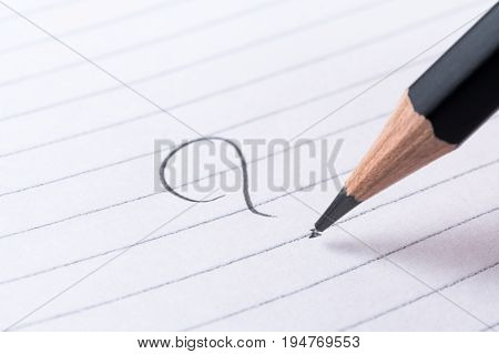Handwritten question mark on a notepad in a what, how, when, where concept.