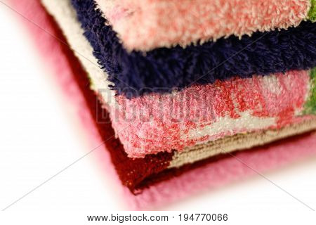 Terry Towels Of Different Colors. Closeup. Isolated On A White Background