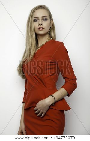 business concept - portrait of a beauty young adult attractive pretty blonde businesswoman in office