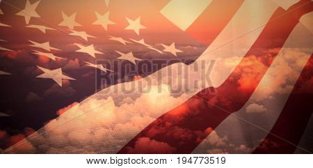 Close up of the us flag against full frame image of cloudy sky
