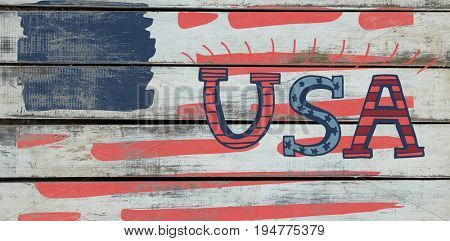 Digitally generated image of USA text against wood background
