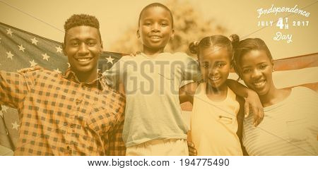Digitally generated image of happy 4th of july message against portrait of happy family with american flag on sunny day