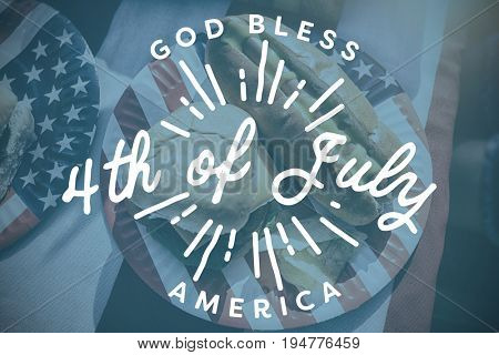 Digitally generated image of happy 4th of july message against american lunch with hot dog and burger