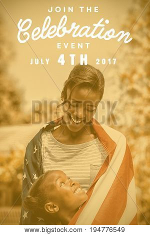 Computer graphic image of independence day message against happy mother and daughter wrapped in american flag at park