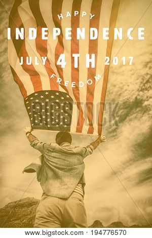Computer graphic image of happy 4th of july text against rear view of man holding american flag against sky