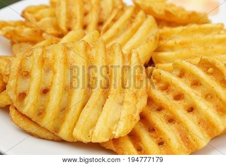 Potato slices in grid cut on white background