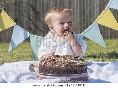 One year old baby boy chocolate cake smash