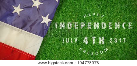 Computer graphic image of happy 4th of july text against closed up view of grass