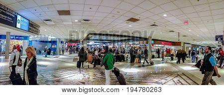 ATLANTA GA USA MARCH 6 2014 - People at intersection of two corridors connecting gates inside Atlanta International Airport on March 6 2014 in Atlanta GA USA.
