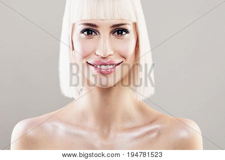 Happy Blonde Woman Fashion Model with Colored Hair. Smiling Blondie Girl with Bob Hairstyle