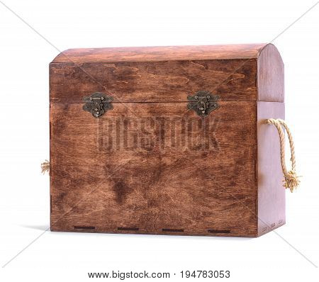 The large brown chest for the multi-colored wooden blocks or toys, isolated on a white background. The wooden case for the game. The box is closed, chest with colorful and wooden cubes.