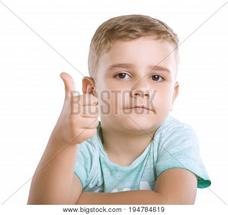 Close-up portrait of a beautiful and cute little child with pretty smiling. A Happy little boy is showing thumbs-up, indicating that everything is well, isolated on a white background.