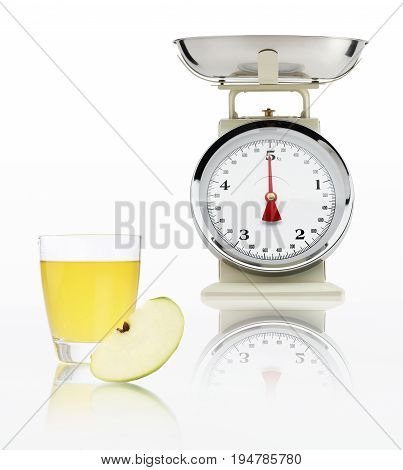 food scale with apple juice glass isolated on white background Balanced diet concept