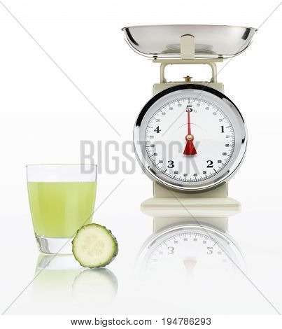 food scale with cucumber juice glass isolated on white background Balanced diet concept