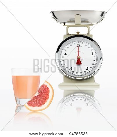 food scale with grapefruit juice glass isolated on white background Balanced diet concept