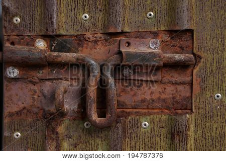 Close up of grungy dusty metal latch.