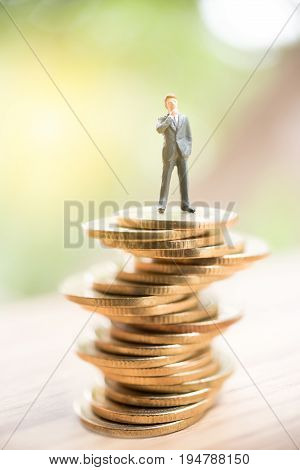 Miniature People Standing On Stack Of Coin,business Concept